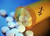 Un bote con pastillas para el Parkinson