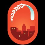 Producto de apoyo de CeliCity con una imagen de una ciudad rojiza, dentro de un marco rojo en forma de gota de agua. Encima de la ciudad una espiga blanca de trigo, que adopta la forma de la gota de agua en su parte superior.