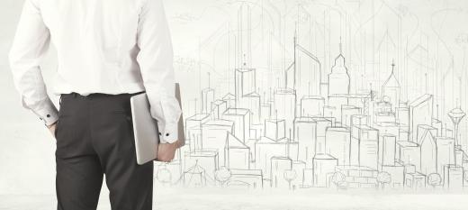 persona con su portátil delante del dibujo de una ciudad con empleo público