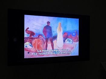 video sobre Munch, cuadro de pareja de espaldas y subtítulo la hemorragia vitrea se reabsorbió totalmente